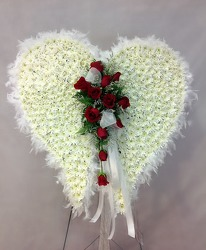 Angel Wings With Red Roses Standing Spray from Carl Johnsen Florist in Beaumont, TX