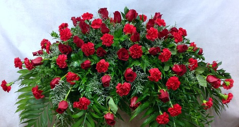 Red Rose and Red Carnation Casket Spray from Carl Johnsen Florist in Beaumont, TX